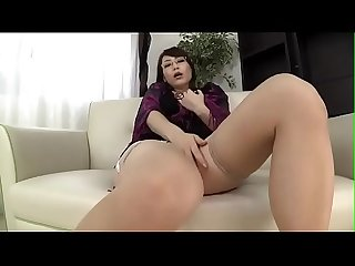 Japanese milf teases and masturbates