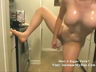 Nerd white babe playing dildo in the kitchen