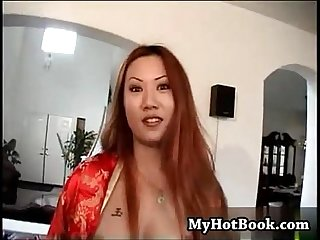 Sin nye is a redheaded asian who opens up her robe