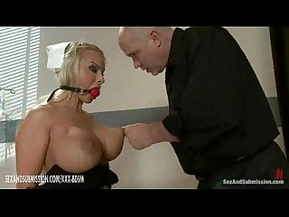 Bald man dominates the bondage busty medical nurse