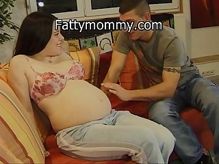 Pregnant latina woman in love with her husband