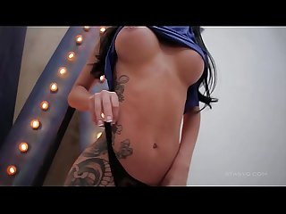Delicate tattooed brunette showing off her perfect body and amazing tits