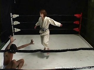 Collared slave is totally beaten up by a domina in the ring