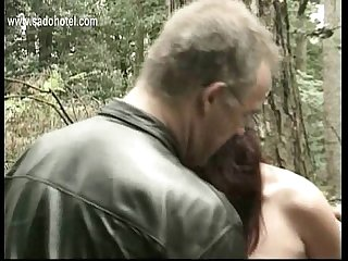 Hot slave tied to tree with heavy weights on her pussy lips gets clamps on her nice tits