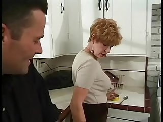 Red haired granny likes to getfucked in her kitchen