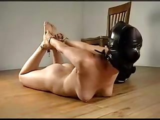 Ballgagged girl gets hooded and chained, hogtied on the ground with no escape