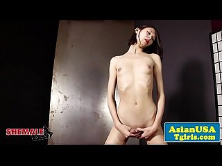 Skinny solo ladyboy playing with her dick