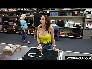 Busty redhead babe trying to sell a chain at the pawn shop