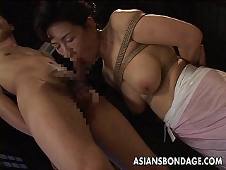 Bound japanese milf sucks on a hard cock