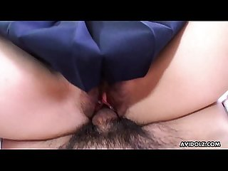 Asian schoolgirl with her uniform on mounts the dudes cock