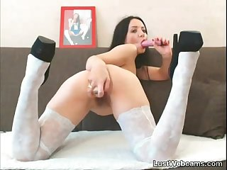 Petite brunette toys her pussy and ass on cam