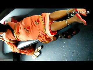 Desi beautiful Indian Aunty showing her beautiful legs from saree in train