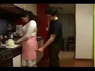 Japanese wife and young boy in kitchen fun