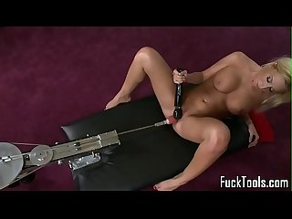Masturbating blonde toys pussy using dildo