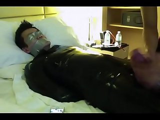 tape gagged asian sub in rubber suit. Being masturbated until he chums.