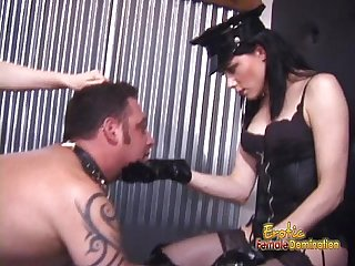 Two ravishing babes enjoy spanking a latex-clad horny stud hard