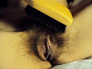 My wife brushing her hairy pussy