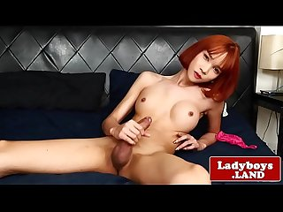 Redhead ladyboy squirts cum after wanking