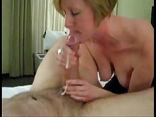 Mature mom sucking big white cock