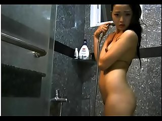 Sexy asian girl fingering herself and showering - Plenty more at Poontangclan.us