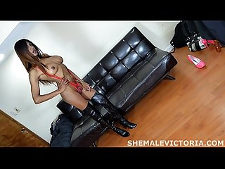 Shemale Escort sticks dildo up asshole