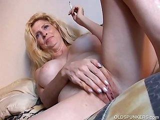 Super sexy old spunker has a smoke and plays with her juicy pussy