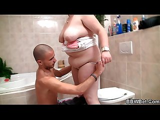 Big belly girlfriend is banged in the bathroom