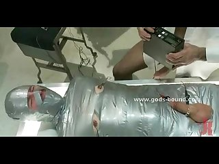 Gay slave wrapped and bound in cuffs