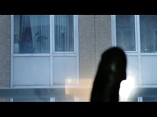 Jerking cock in front of window woman caught and watch