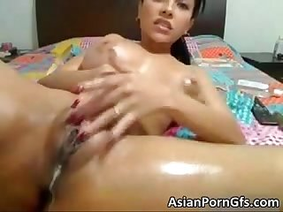 Asian hottie with huge juggs massage her