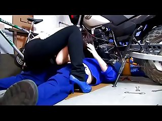 She helps the mechanic giving a blow job
