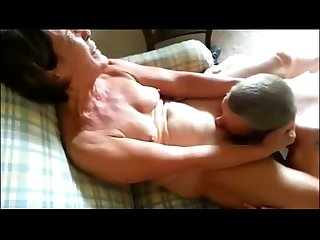 Mature lady receiving oral sex