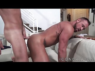 Muscular tattooed hunks anally fuck on the bed