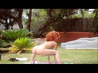 Stunning redhead teen working out outside