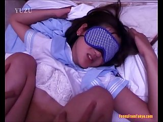 A young asian Girl wearing a blindfold is laying on from http colon sol sol alljapanese period net