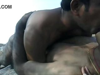 Two indian men doing foreplay outdoors