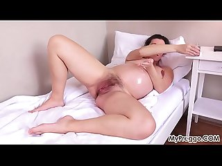 Pregnant corazon oiled up and masturbating