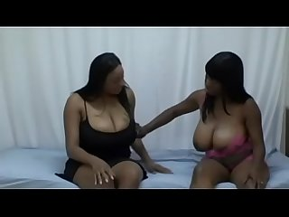 Black ebony BBWs Lola Lane and Carmen Hayes stroke each others massive gorgeous tits on bed
