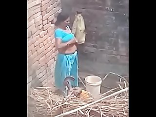 My neighbour Aunty bathing showing her big boobs