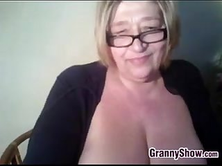 Thick grandma plays with her big tits