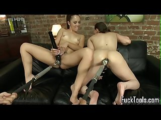 Toy lesbians spread legs for dildo machine