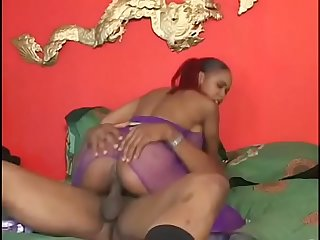 Redhead babe in purple fishnet Lil Asss loves to take it in a doggy style position
