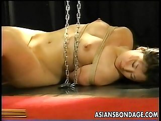 Two Asian bitches are tied up poked and proded