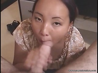 Cute Asian girlfriend giving blowjob