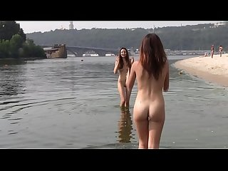 Naughty young nudists play with each other in sand