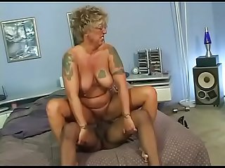 Mature lady screwed by her african stallion when her husband is away
