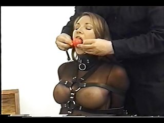 Very cute Andrea neal is bound gagged and blindfolded wearing a sexy outfit