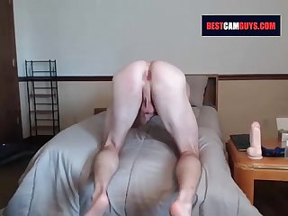 Muscular guy opens his ass with a huge dildo - on bestcamguys.com