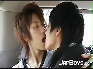 Japanese twinks kissing passionately in the back of the car